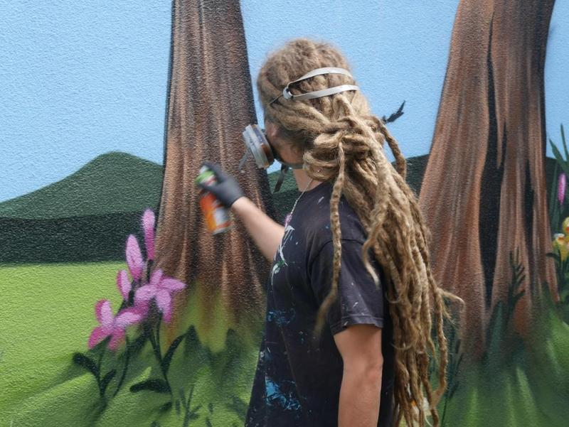 Andy whilst painting wall art