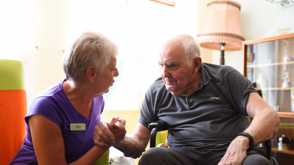 carer and resident talking