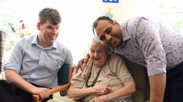 care team sit with resident
