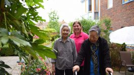 carer with tenants in Colliers garden